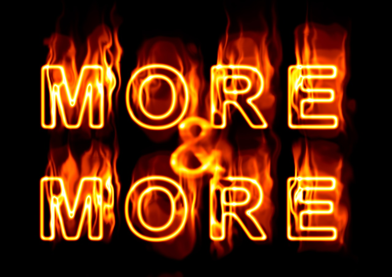 words 'more & more' in flames